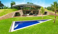 Bauen Architects hillside home built into landscape Paraguay. Buena Arquitectura.