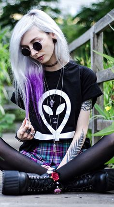 Kimi Peri showing her inner gothic school girl with Cryptic Apparel's Alien Ankh Tee. Cryptic Apparel brings you best in mens and womens streetwear fashion.