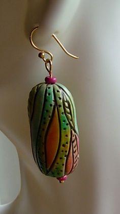 Frida Kahlo inspired earring I by Polymer Penguin, via Flickr