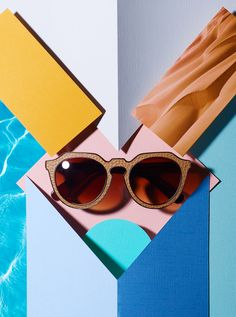 Still life of sunglasses and paper. Styled by Yvonne Achato. Photography by Michael Hedge.