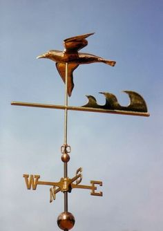 """Seagull Soaring Weather Vane by West Coast Weather Vanes.  The waves have been added as a """"wind catcher"""" to insure that the weather vane turns correctly in the wind. A weathervane must have more surface area to the back of the pivot point to turn accurately. By adding the waves, as the wind blows by the sculpture piece, it will cause it to turn so the beak of the pelican faces into the wind."""