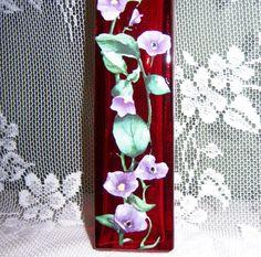 Red vase - purple floral with swarovski crystals. $10.00, via Etsy.