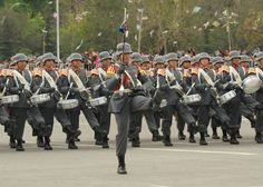 The drum corps of the Sgt. Daniel Rebolledo Sepulveda NCO School marching through O'Higgins Park in Santiago at the 2013 Chilean Army Day Parade.