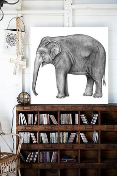 the elephant is lovely, but the bookcase makes my heart go pitter-pat lol