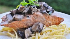 The rustic flavor of fresh mushrooms in a creamy Parmesan cheese sauce is a winning combination. Paired with the gentle texture of angel hair pasta and mild salmon, this entree is an economical method to make your salmon go a long way. The pasta is filling and the mushrooms give the dish some height, so one typical portion of salmon does double duty.