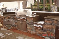 7' island. Stone front. Stucco 3 sides.  Grill + power burner for steaming crabs, corn.  http://www.customgrillbuilders.com/