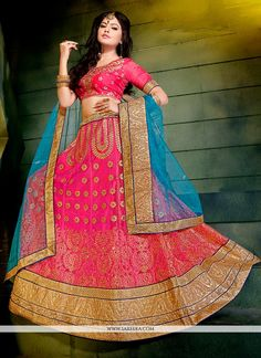This eye catching elegant drape is perfect for any occasion. Be the sunshine of everyone's eyes dressed in this beautiful hot pink net a line lehenga choli. This attire is encrafted with embroidered...