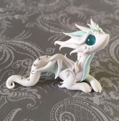 Wispy Ghost Dragon by DragonsAndBeasties.deviantart.com on @DeviantArt