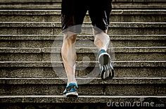Athlete man with strong leg muscles training and running urban city staircase in sport fitness and healthy lifestyle concept