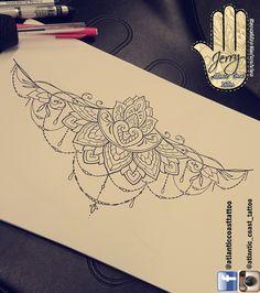 Beautiful underboob sternum tattoo idea design for a thigh arm by dzeraldas jerry kudrevicius from Atlantic Coast tattoo.  Mandala lotus lace tattoo design with pretty patterns.