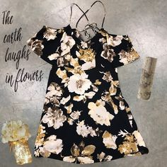 This black floral spaghetti strap cold shoulder dress is perfect for frolicking into spring!🌼The ruffle overlay across the front and crisscross straps along the back make it extra sweet!😉 | Shop this product here: http://spreesy.com/frolicboutique/87 | Shop all of our products at http://spreesy.com/frolicboutique    | Pinterest selling powered by Spreesy.com