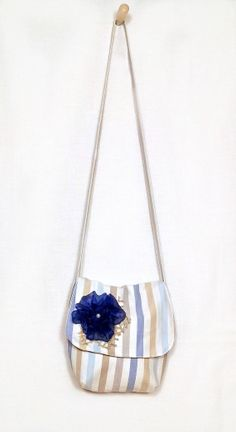 Large sling bag set decorated with a navy blue veil flower ...