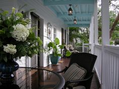 Key West style porch. Look at the blue ceiling
