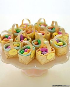 ALMOND EASTER BASKET FAVORS Let guests tote away sweet almonds in tiny baskets. Line each with colored mini paper liners, and th...