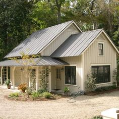 Metal roof and siding. Good idea for building in a treed area....