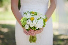 Petite Bridal Bouquet Comprised Of: White Ranunculus, White Freesia, Yellow Craspedia (Billy Balls), Green Hypericum Berries, Green Snowball Viburnum + Green Foliage