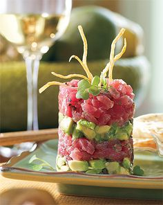 Oh yes.....Fresh Ahi tuna Napoleon layered with freshly made guacamole, soy, and sesame oil.