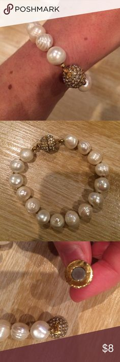 Bling Pearl Bracelet Gorgeous pearl bracelet with a fun bling magnetic clasp! Awesome for formal or casual wear. Obviously these are not real pearls, but they are beautiful nonetheless! The bling piece is gold covered in rhinestones. Jewelry Bracelets