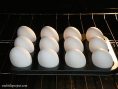 Baked Hard Boiled Eggs Recipe 1.Place a dozen eggs (or however many you want) in a mini or regular muffin tin. 2.Preheat the oven to 325F then put the eggs in and bake for 30 minutes. 3.Remove from the oven and instantly immerse in cold water for 10 minutes. 4.For easiest peeling, remove the shells right away, otherwise refrigerate until needed.