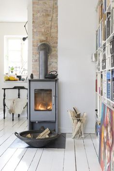 Wonderful wood burning stove in Copenhagen. I have a hearth for a stove in the family room, this one is cool Style At Home, Modernisme, Home Fireplace, Small Fireplace, Log Burner, Home Fashion, Home And Living, Living Rooms, Small Spaces