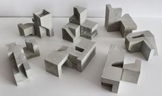 Concrete modular sculpture based on the Soma Cube geometry. By David Umemoto