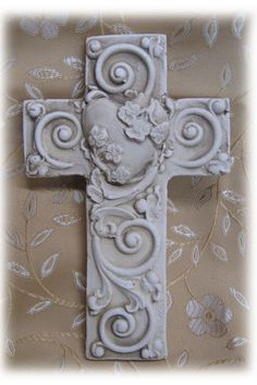 Handmade one at a time fom individual molds. Each hand crafted piece shows a slight variation from one to another which adds the uniqueness to each cross. - Antique White finish - Keyhole back for eas