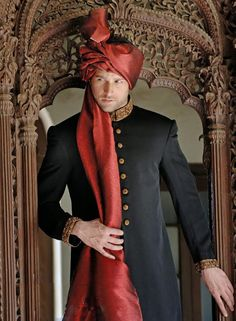 Silk maroon Jodhpuri style groom Pagri with long layering of turban.