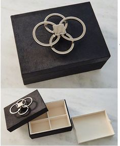 New product: Layered Circle Box-Black Hair on Hide - Solid nickel finished rings sit atop black calf hair on hide.  Open the lid to reveal a removable tray insert and segmented storage space.  An elegant and lovely piece to add to a vanity or desktop. #globalviews