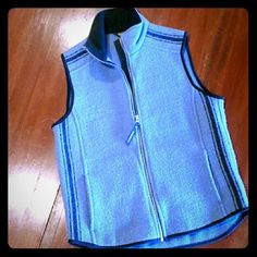 Woolrich Technowool vest. Wedgewood blue with black trim. Full zip with two side pockets & fleece lined collar. Purchased new, only worn a few times. Fits a little big for me. It's beautiful: can be worn with a wool skirt, jeans or ski pants. Ladies small, 4 -6. Woolrich Jackets & Coats Vests