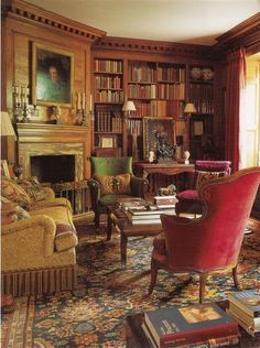 *Sigh*.....would love to have my own library....warm wood, overstuffed furniture and the smell of books!