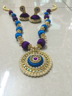 Fancy necklace made with silk thread and Woden beads with a nice matching pair of silk thread earrings Silk Thread Jumkas, Silk Thread Bangles Design, Silk Thread Necklace, Silk Bangles, Beaded Necklace Patterns, Thread Jewellery, Jewelry Patterns, Beaded Jewelry, Thread Art