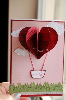 By Marta. Try making the hot air balloon from die-cut hearts. Use die-cut grass & dry embossed die-cut clouds.