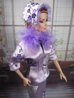 Integrity Toy's Victoire modeling Lavender silk suit with brocade blossoms and large feather collar.