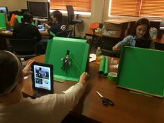 ECISD Technology Ambassadors on Genius Day creating Green Screen in Miniature using Pizza Boxes and iPads