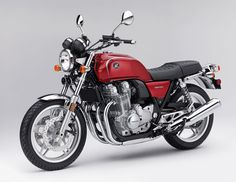 Like the old school cafe look.             2014 Honda CB1100 Deluxe in Candy Red