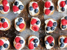 Quick & Easy 4th of July appetizer:  Summer Berry Crostini with Lemon-Ricotta & drizzled with honey.