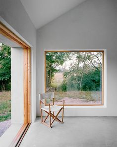 Minimalist house on island of Gotland is designed by Swedish architecture studio Etat Arkitekter. The family vacation house is built with concrete and wood. Interior Architecture, Interior Design, Architect House, Prefab Homes, Minimalist Home, Home And Living, New Homes, Sliding Windows, Wood Windows