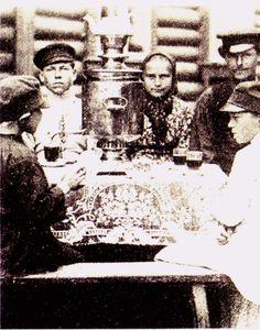 Russian children drinking #tea from a samovar in winter.