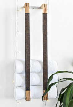 One of a kind Luxury towel rack made of maple, walnut inserts, vegan leather and aluminum mounting brackets. Each piece is hand planed, mitered and put together with care and very close attention to detail. The towel racks are extremely durable hardwood, and look amazing in any room. The two side pieces are carefully wrapped in grainy brown crazy horse vegan leather. You can't go wrong adding this style to your home decor.