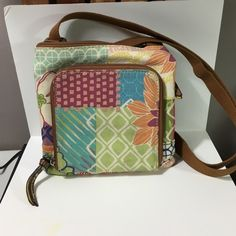 Small Fossil bag Small Fossil bag with shoulder strap. Very cute & colorful Fossil Bags Shoulder Bags