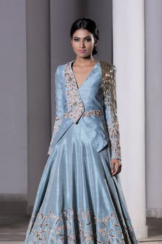 Ice Blue hand embroidered trail lehenga with a jacket set. Fabric: Raw Silk Care: Dry Clean Only