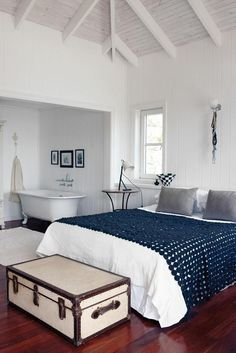 The bedroom in a bungalow in Bakhoven, Cape Town, designed by Pieter Silberbauer, House and Leisure via Remodelista