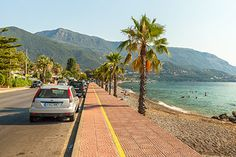 Pe coasta de nord-est a insulei, imediat dupa Corfu Town, statiuni superbe sunt insiruite una dupa alta, intr-un peisaj de vis, la poalele Pantokratorului care se intinde pana la Marea Ionica. Printre ele, cu o superba priveliste spre coasta Albaniei, se remarca Dassia si Ipsos, la aproape doi kilometri una de cealalta. Atat Dassia cat si Ipsos sunt potrivite ca destinatie pentru o vacanta activa, si un sejur dedicat distractiei... Corfu Greece, Albania, Country Roads, Holiday, Summer, Vacations, Summer Time, Holidays, Vacation