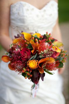 Burnt orange bouquet with calas, pin cushions and roses. Wedding Flowers, Wedding Day, Pin Cushions, Burnt Orange, Flower Arrangements, Bouquet, Roses, Autumn, Table Decorations