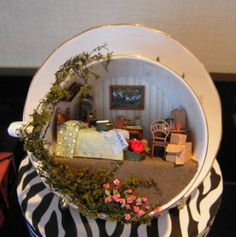 Bedroom in a teacup. I would ling this with a plate hanger.