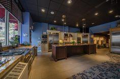 Living kitchen showroom. Jenn-Air appliances. Stainless steel.