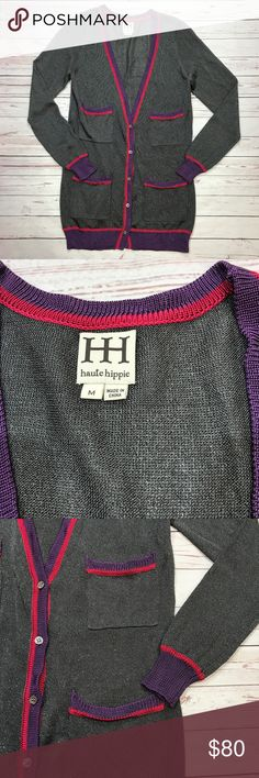 """HAUTE HIPPIE Metallic Gray Cardigan Medium HAUTE HIPPIE CARDIGAN SWEATER. ITS A RAYON,NYLON, POLY BLEND WHICH MAKES IT FEEL VERY SILKY. DARK GREY WITH FLECKS OF SILVER RUNNING THROUGHOUT THE CARDIGAN. THERE ARE 2 TOP AND 2 BOTTOM FRONT POCKETS. THE SWEATER  IS TRIMMED IN A PURPLE AND RED STRIPE AND BUTTONS IN FRONT.  Size Medium  Has been in storage  RETAIL $375.00  CHEST 17.5"""" UNDERARM TO UNDERARM SLEEVES 1/2 LENGTH LENGTH 20"""" TOP OF SHOULDER TO HEM Haute Hippie Sweaters Cardigans"""