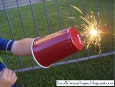 A plastic cup will keep little hands safe when handling sparklers on Fourth of July. Mom Hacks, Sparklers, Activities For Kids, Safety Tips, Our Kids, Fun Desserts, Make It Yourself, Safe Kids, Canning