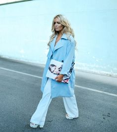 Fanny Lyckman - light blue long trench coat and loose white pants with loose wavy hair