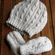 This set includes a cabled hat and thumbless mittens sized for a 6-12 month old baby. Both the hat and mittens are done in the round. Experienced knitters can probably adapt the pattern to be done on straight needles, adding an extra stitch for seaming.